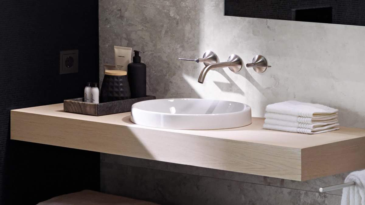 Умивальник в маленьку ванну – підвісний, кутовий: види