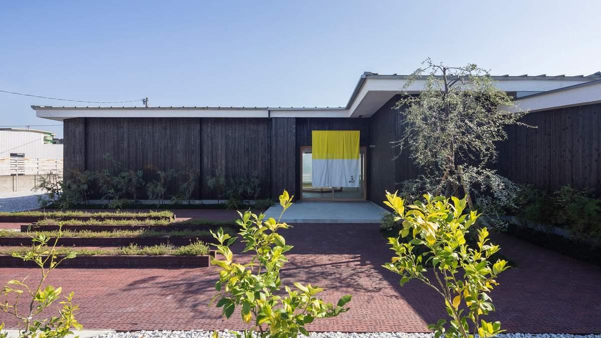 Архітектурна компанія використовує старі бочки для облицювання фасаду – фото