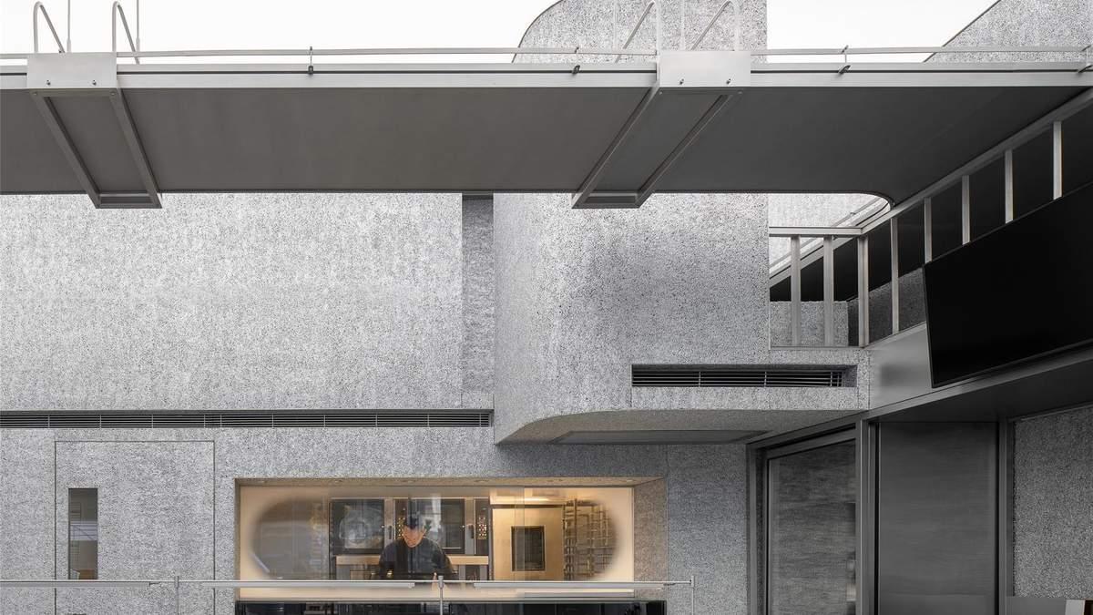 Концептуальний інтер'єр: суцільний сірий дизайн магазину в Китаї – фото