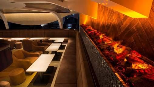 Каміни в інтер'єрі: як виглядають готелі і ресторани з таким дизайном